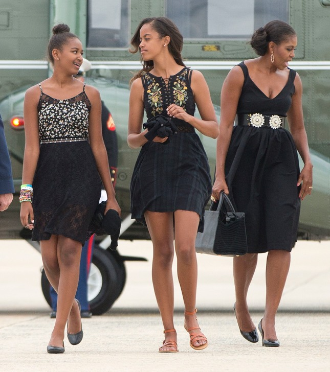 The Obama Women, The Graceful American Experience credit: AP Photo/Pablo Martinez Monsivais